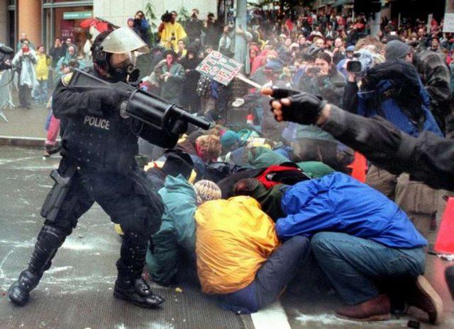 Militarized police confront civilians